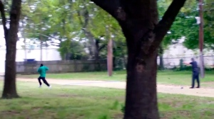 In this April 4, 2015 image from video, Walter Scott, left, is shot by police officer Michael Thomas Slager in Charleston, S.C. (Feidin Santana via AP)