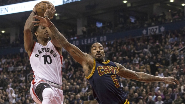 Cleveland Cavaliers guard J.R. Smith (right) tries to stop Toronto Raptors guard DeMar DeRozan drives to the basket during first half NBA basketball action in Toronto on Monday, Dec. 5, 2016. (Chris Young / THE CANADIAN PRESS)