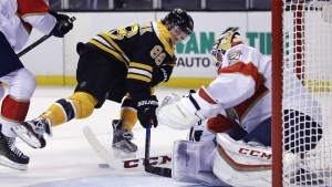Florida Panthers goalie Roberto Luongo, right, makes a stick save on a shot by Boston Bruins right wing David Pastrnak (88) during the second period of an NHL hockey game in Boston, Monday, Dec. 5, 2016. (AP / Charles Krupa)