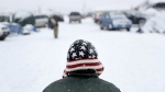 United States Marine Corps veteran Frank Russano, of the Outer Banks, N.C., walks through the Oceti Sakowin camp where people have gathered to protest the Dakota Access oil pipeline in Cannon Ball, N.D., Monday, Dec. 5, 2016. (AP / David Goldman)