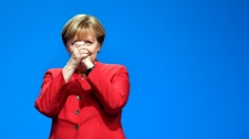 German Chancellor and Chairwomen of the CDU, Angela Merkel, gestures after her speech as part of a general party conference of the Christian Democratic Union (CDU) in Essen, Germany, Tuesday, Dec. 6, 2016. Merkel wants to secure the backing of her conservative party to head up the party's campaign for next September's election. (AP Photo/Martin Meissner)