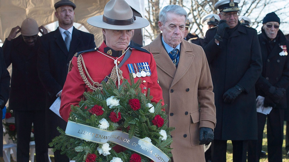 Nova Scotia Lt.-Gov. J.J. Grant prepares to lay a wreath at the Halifax Explosion Memorial Bell Tower on Fort Needham in Halifax on Tuesday, Dec. 6, 2016. Ninety-nine years ago, on Dec. 6, 1917, the SS Mont-Blanc, a French cargo ship loaded with wartime explosives, collided with the Norwegian vessel SS Imo in the harbour. Nearly 2000 people were killed and thousands more wounded in the blast. (THE CANADIAN PRESS/Andrew Vaughan)