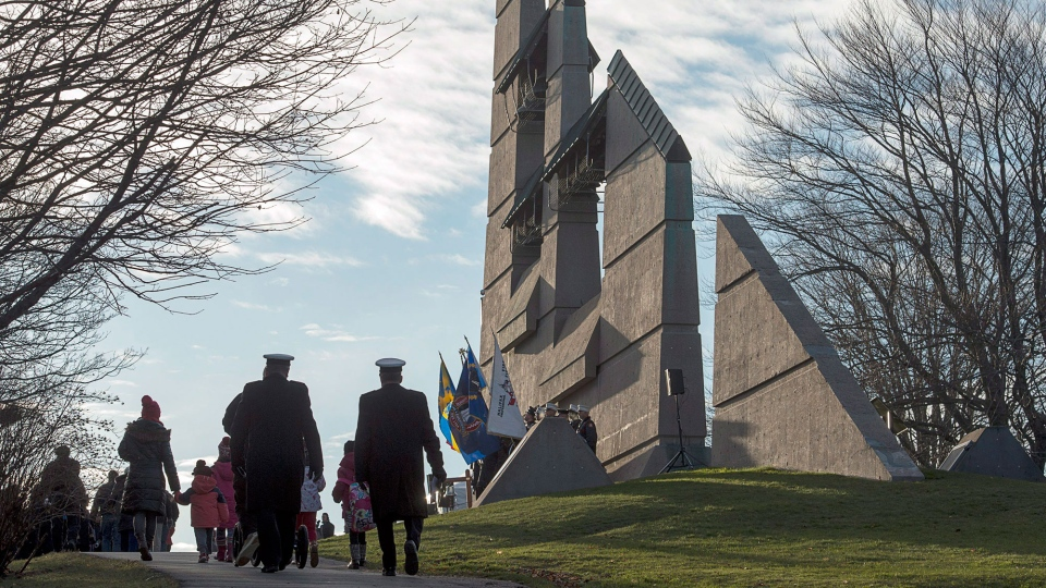 A crowd of several hundred gathered at the Halifax Explosion Memorial Bell Tower on Fort Needham in Halifax on Tuesday, Dec. 6, 2016. Ninety-nine years ago, on Dec. 6, 1917, the SS Mont-Blanc, a French cargo ship loaded with wartime explosives, collided with the Norwegian vessel SS Imo in the harbour. Nearly 2000 people were killed and thousands more wounded in the blast. (THE CANADIAN PRESS/Andrew Vaughan)