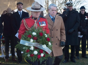 Nova Scotia Lt.-Gov. J.J. Grant prepares to lay a wreath at the Halifax Explosion Memorial Bell Tower on Fort Needham in Halifax on Tuesday, Dec. 6, 2016. (Andrew Vaughan / THE CANADIAN PRESS)