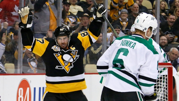 Pittsburgh Penguins' Sidney Crosby (87) celebrates his goal in the second period of an NHL hockey game against the Dallas Stars in Pittsburgh on Dec. 1, 2016. (Gene Puskar/AP)