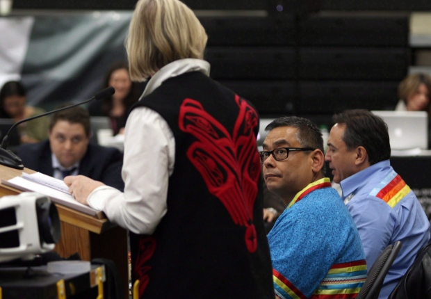 Regional Chief Shane Gottfriedson (centre) looks on as Carolyn Bennett, Minister of Indigenous and Northern Affairs, speaks at the Assembly of First Nations' annual general meeting at the Songhees Wellness Centre in Victoria, B.C. Monday, October 24, 2016. (THE CANADIAN PRESS/Chad Hipolito)