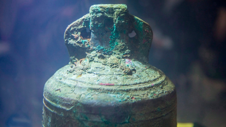 The ship's bell from the recently discovered Franklin Expedition shipwreck HMS Erebus sits in pure water after being recovered in Ottawa on Thursday, Nov. 6, 2014. THE CANADIAN PRESS/Justin Tang