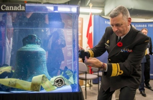 Royal Canadian Navy Rear Admiral John Newton takes a picture of the ship's bell from the recently discovered Franklin Expedition shipwreck HMS Erebus in Ottawa on Thursday, Nov. 6, 2014. The shipwreck from the famed expedition in search of the Northwest Passage was found during the 2014 Victoria Strait Expedition. (THE CANADIAN PRESS/Justin Tang)