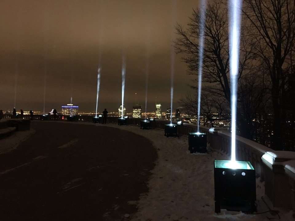 Fourteen beams of light on Mount Royal represent the victims of the Polytechnique Massacre. (CTV Montreal / Stephane Giroux)
