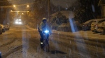 FILE - A cyclist pushes on through snow and slush in Victoria after a snowfall on Dec. 5, 2016 (CTV Vancouver Island)