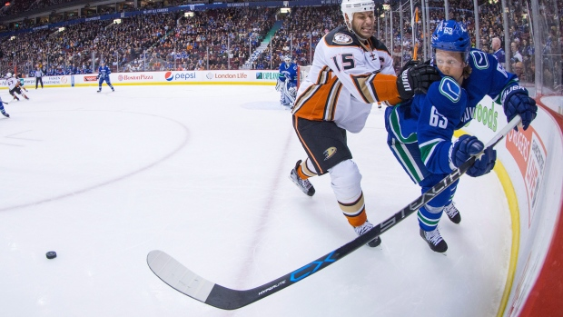 Hall leads Devils over Canucks with goal, assist and hit