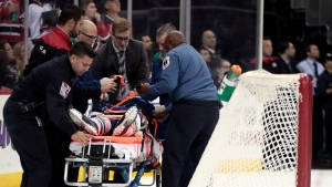 Vancouver Canucks defenseman Philip Larsen, of Finland, is carried onto a stretcher after a hit by New Jersey Devils left wing Taylor Hall during the second period of an NHL hockey game, Tuesday, Dec. 6, 2016, in Newark, N.J. (AP Photo / Julio Cortez)