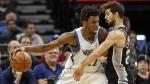 Minnesota Timberwolves forward Andrew Wiggins (22) drives against San Antonio Spurs guard Nicolas Laprovittola (27) in the second quarter of an NBA basketball game Tuesday, Dec. 6, 2016, in Minneapolis. (AP / Bruce Kluckhohn)