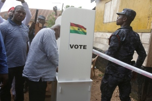 Nana Akufo-Addo, presidential candidate of the opposition New Patriotic Party, makes a thumb print before casting his vote during the Presidential and parliamentary elections in Kibi, eastern Ghana, on Dec. 7, 2016. (Sunday Alamba / AP)