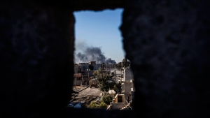 Smoke rises at the frontline, seen from an Iraqi army shooting position in Shyma district in Mosul, Iraq, on Dec. 6, 2016. (Manu Brabo / AP)