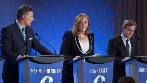 Lisa Raitt is flanked by Maxime Bernier, left, and Andrew Saxton at the Conservative leadership candidates' bilingual debate in Moncton, N.B. on Tuesday, Dec. 6, 2016. Conservatives vote for a new party leader on May 27, 2017. THE CANADIAN PRESS/Andrew Vaughan