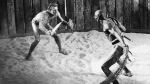 Kirk Douglas, left, in the title role as a Roman slave and gladiator, Spartacus, battles Woody Strode in Hollywood, Ca., in April, 1959. (AP)