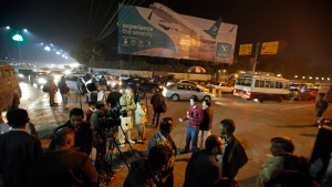 Pakistani media and residents gather at Benazir Bhutto International Airport in Islamabad, Pakistan, on Dec. 7, 2016. (Anjum Naveed / AP)