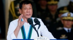Philippine President Rodrigo Duterte addresses troops during change-of-command ceremony at Camp Aguinaldo in Quezon city, northeast of Manila, Philippines on Wednesday, Dec. 7, 2016. (AP / Bullit Marquez)