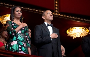 U.S. President Barack Obama and first lady Michelle Obama, put their hand over their heart as the national anthem is sang during the Kennedy Center Honors Gala at the Kennedy Center in Washington, Sunday, Dec. 4, 2016. (AP Photo/Manuel Balce Ceneta)