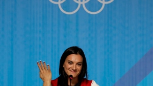 FILE- In this Friday, Aug. 19, 2016 file photo, Yelena Isinbayeva, Russia's pole vault world record holder, speaks during a news conference at the 2016 Summer Olympics in Rio de Janeiro, Brazil. (AP Photo/Gregory Bull, File)