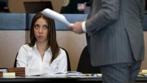Dalia Dippolito listens to attorney Brian Claypool speak at the Palm Beach County Courthouse in West Palm Beach, Fla., Monday, Dec. 5, 2016. (Allen Eyestone / Palm Beach Post via AP)