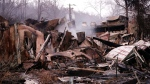 Smokes rises out of the remains of a burned-out business Wednesday, Nov. 30, 2016, in Gatlinburg, Tenn., after a wildfire swept through the area Monday. Tornadoes that killed five people are adding to an onslaught of drought, flood and fire plaguing the South. The deadly overnight storms crashed into Alabama and Tennessee just as crews began to control wildfires around the resort town of Gatlinburg. (AP Photo/Mark Humphrey)