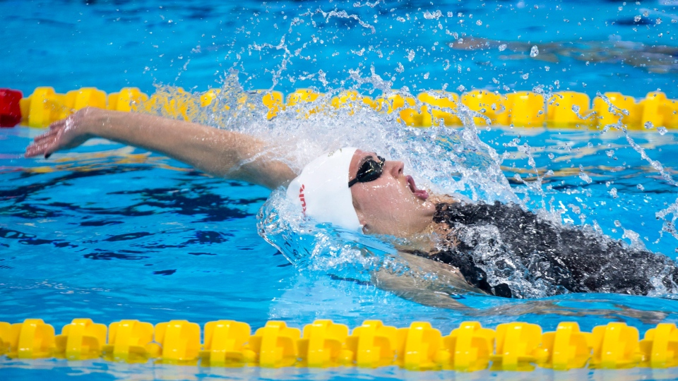 Canada's Kylie Jacqueline Masse swims to win the silver medal in the women's 100 metre backstroke at the FINA world short-course swimming championships Wednesday, December 7, 2016 in Windsor, Ont. (Paul Chiasson/The Canadian Press)