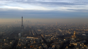 The Eiffel Tower and The Invalides dome, right, are seen from the Montparnasse Tower, as Paris suffers a pollution spike on Wednesday, Dec. 7, 2016. (AP / Francois Mori)