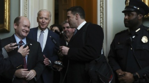 Vice President Joe Biden, centre, walks with Sen. Christopher Coons, D-Del., left, to a bipartisan reception in Biden's honor after a tribute as former senator and President of the Senate on Capitol Hill in Washington, Wednesday, Dec. 7, 2016. (AP / Manuel Balce Ceneta)