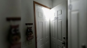 Snow piled high as door outside North Dakota home