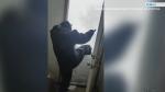 Resident kick down snow piled high