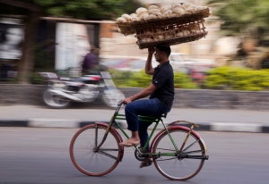 In this Nov. 19, 2016 file photo, an Egyptian carries a basket of bread, in Cairo, Egypt. (AP / Amr Nabil)