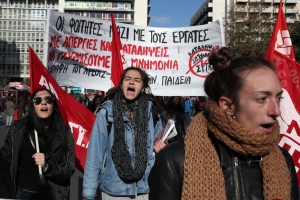 University students shout slogans during a protest in Athens, Thursday, Dec. 8, 2016. A nationwide 24-hour general strike called by unions against austerity measures disrupted public services across Greece on Thursday, while thousands marched in protest in central Athens. (AP Photo/Yorgos Karahalis)