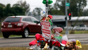 A memorial of flowers and balloons are placed at the scene , Tuesday, Dec. 6, 2016 where ex-NFL player Joe McKnight was killed in a road rage incident last week in Terrytown, La. (Gerald Herbert/AP Photo)
