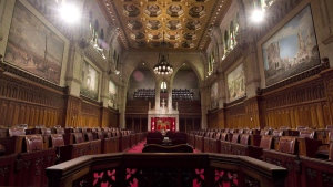 The Senate chamber sits empty on September 12, 2014 in Ottawa. THE CANADIAN PRESS/Adrian Wyld