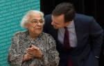 Minister of Finance Bill Morneau speaks with Wanda Robson, sister of Viola Desmond during a ceremony in Ottawa, Thursday December 8, 2016. (Adrian Wyld / THE CANADIAN PRESS)