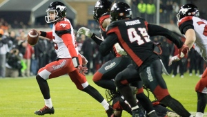 Calgary Stampeders quarterback Andrew Buckley (15) runs the ball against the Ottawa Redblacks during fourth quarter CFL Grey Cup action Sunday, November 27, 2016 in Toronto. (THE CANADIAN PRESS / Peter Power)