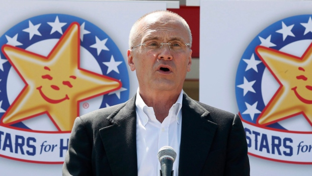 In this Aug. 6, 2014 photo provided by CKE Restaurants, CEO Andy Puzder speaks at a news conference in Austin, Texas. (Jack Plunkett/CKE Restaurants via AP)