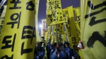 Protesters holding banners march toward the National Assembly during a rally demanding the impeachment of South Korean President Park Geun-hye in Seoul, South Korea on Thursday, Dec. 8, 2016. (AP / Ahn Young-joon).