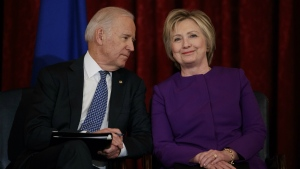 Vice President Joe Biden, left, talks with former Secretary of State Hillary Clinton during a ceremony to unveil a portrait of Senate Minority Leader Harry Reid, D-Nev., on Capitol Hill in Washington on Thursday, Dec. 8, 2016. (AP / Evan Vucci)