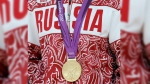 FILE - In this Aug. 10, 2012 file photo a gold medalist from Russia participates in a medals ceremony at the 2012 Summer Olympics in London. (AP Photo/Paul Sancya, file)