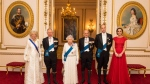 Queen Elizabeth II and Prince Philip, Prince Charles and the Duchess of Cornwall, left, Prince William and the Duchess of Cambridge arrive for the annual evening reception for members of the Diplomatic Corps at Buckingham Palace, London, Thursday Dec. 8, 2016. The Duchess of Cambridge wears the Cambridge Lover's Knot Tiara, a favorite tiara of the late Princess Diana. (Dominic Lipinski/PA via AP)