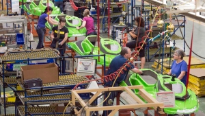 Employees work on the SeaDoo assembly line at the Bombardier Recreational Products plant Thursday, June 12, 2014 in Valcourt, Que. (Ryan Remiorz/The Canadian Press)