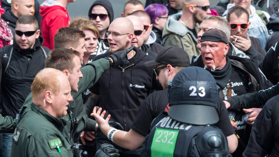 German riot police officers clash with participants of a rally of the extreme right-wing party 'Die Rechte' (The Right) on May Day in Erfurt, Germany, Sunday, May 1, 2016. (Jens Meyer/AP)