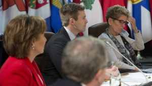 Ontario Premier Kathleen Wynne rubs her forehead as she listens with New Brunswick Premier Brian Gallant, B.C. Premier Christy Clark and Saskatchewan Premier Brad Wall to Prime Minister Justin Trudeau deliver remarks at the First Ministers' Meeting in Ottawa, Friday, December 9, 2016. THE CANADIAN PRESS/Adrian Wyld