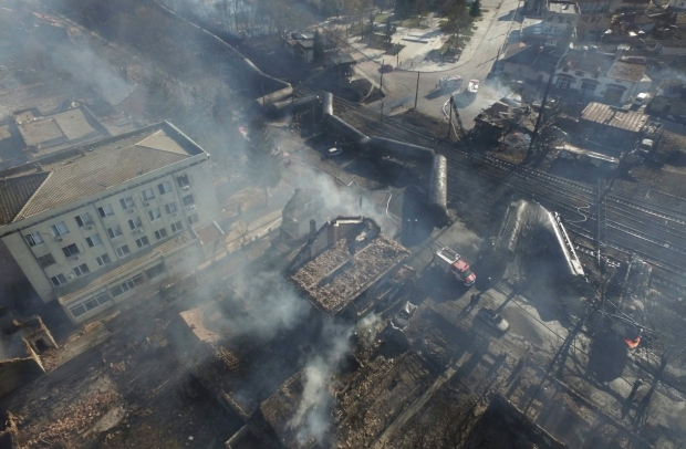 In this aerial view emergency services attend the scene of devastation as smoke rises after a tanker train derailed and a gas tank exploded in the village of Hitrino, northeastern Bulgaria, early Saturday, Dec. 10, 2016. (Petar Petrov / Sky Pictures Bulgaria)