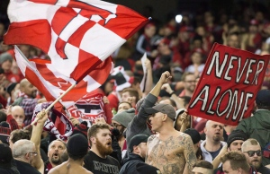 Toronto FC fans cheer on their team prior to the first leg of the MLS Eastern Conference final against the Montreal Impact at the Olympic Stadium in Montreal, Tuesday, November 22, 2016. (Graham Hughes / THE CANADIAN PRESS)