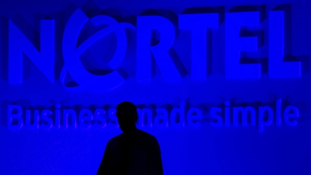 Nortel Networks President and CEO Mike Zafirovski stands in the shadows during his presentation at the company's annual general meeting in Toronto, Thursday, June 29, 2006. (Adrian Wyld / THE CANADIAN PRESS)