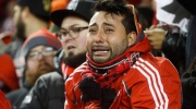 A Toronto FC fan reacts after his soccer club lost to the Seattle Sounders during a penalty shootout in MLS Cup soccer final action in Toronto on Saturday, December 10, 2016. THE CANADIAN PRESS/Mark Blinch